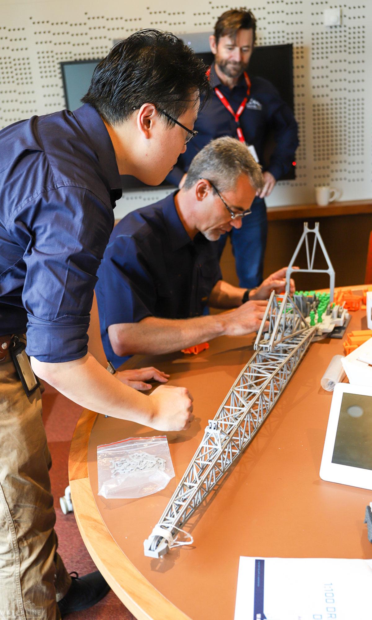 Waterline's Mike Hsu and Randall Makin, walking Johan Vilojen of BHP through how the model works