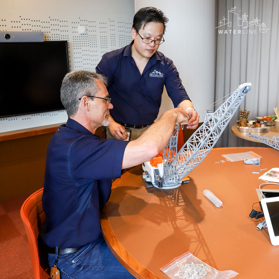 Waterline's Mike Hsu with the BHP 3D-printed Dragline at BHP office